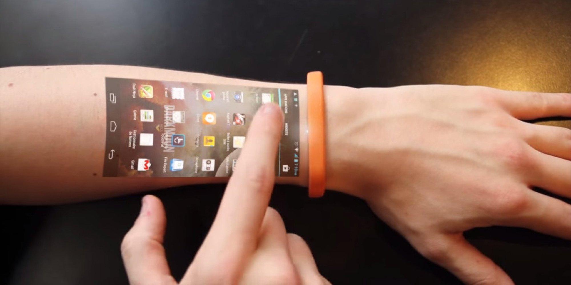 Часы, превращающие руку в тачскрин новые фото